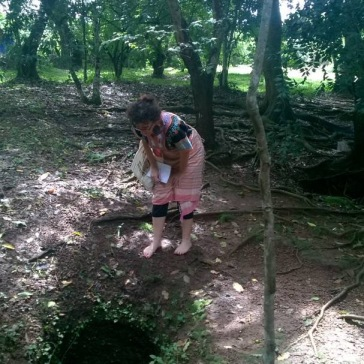 Charlotte - Diary of a mzungu peers down in to one of the scattered pits.