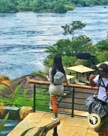 Kim Kardashian enjoying the view of the Nile at Chobe Safari Lodge